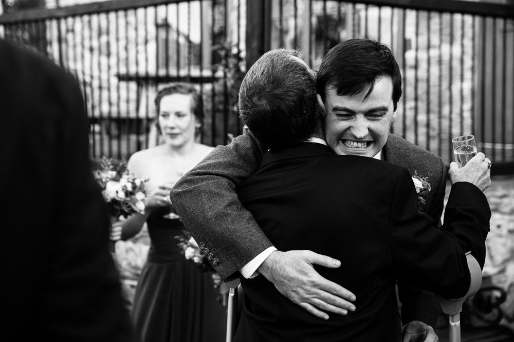 Groom wedding hug